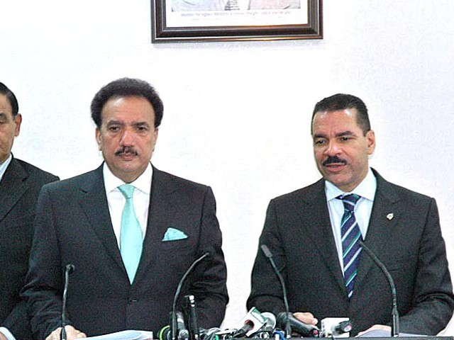 Interior Minister Rehman Malik and Interpol Secretary General Ronald Noble address the media. PHOTO: APP