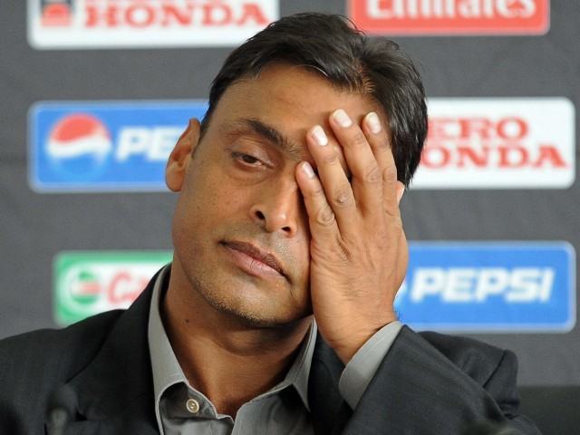 Pakistani paceman Shoaib Akhtar reacts during a press conference in Colombo on March 17, 2011. PHOTO: AFP